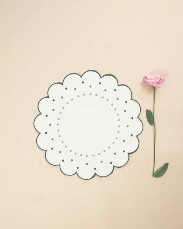 Flower shaped placemat with green embroidered borders and embroidered green dot details