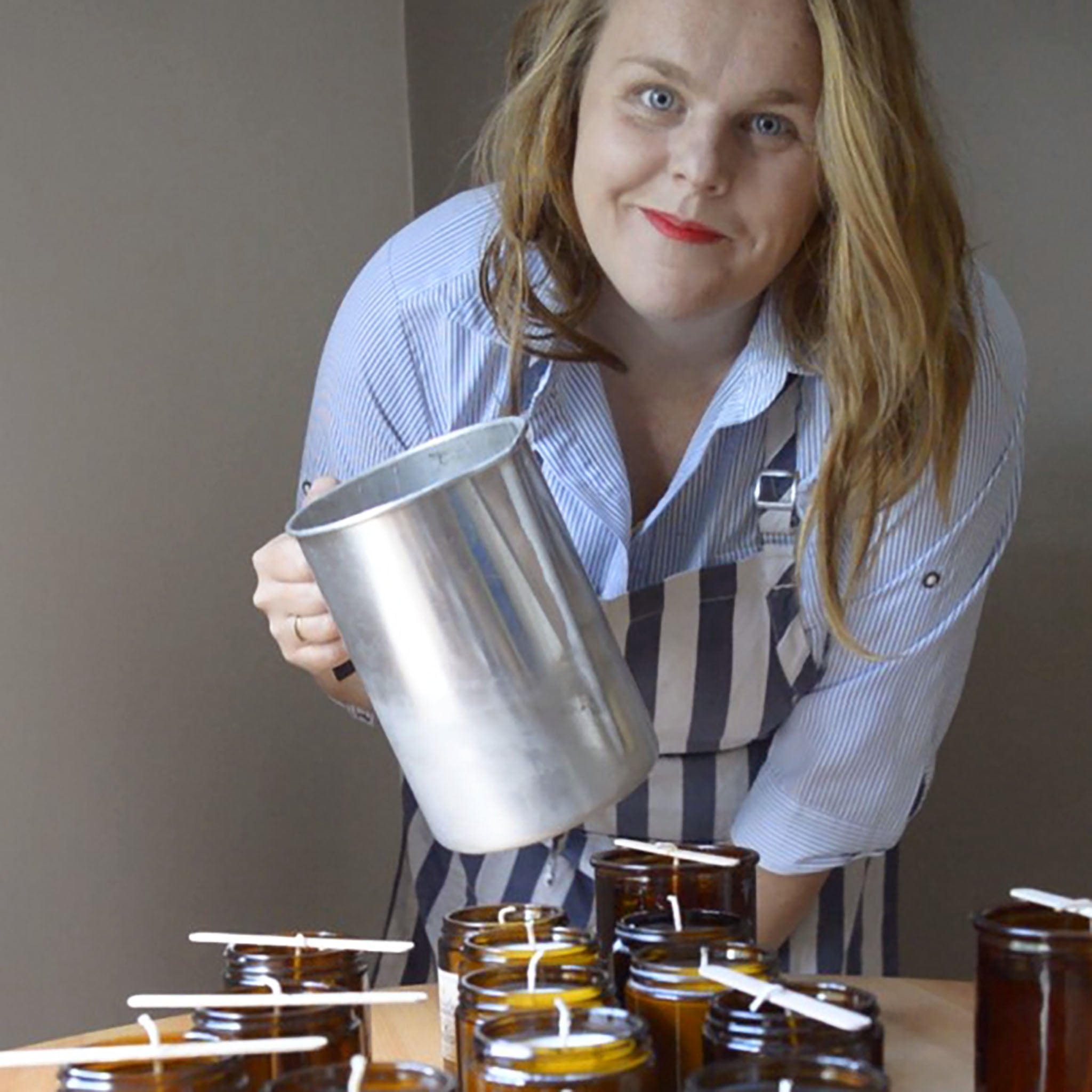 Lucinda from Scents of Saudade pouring handmade soy candles