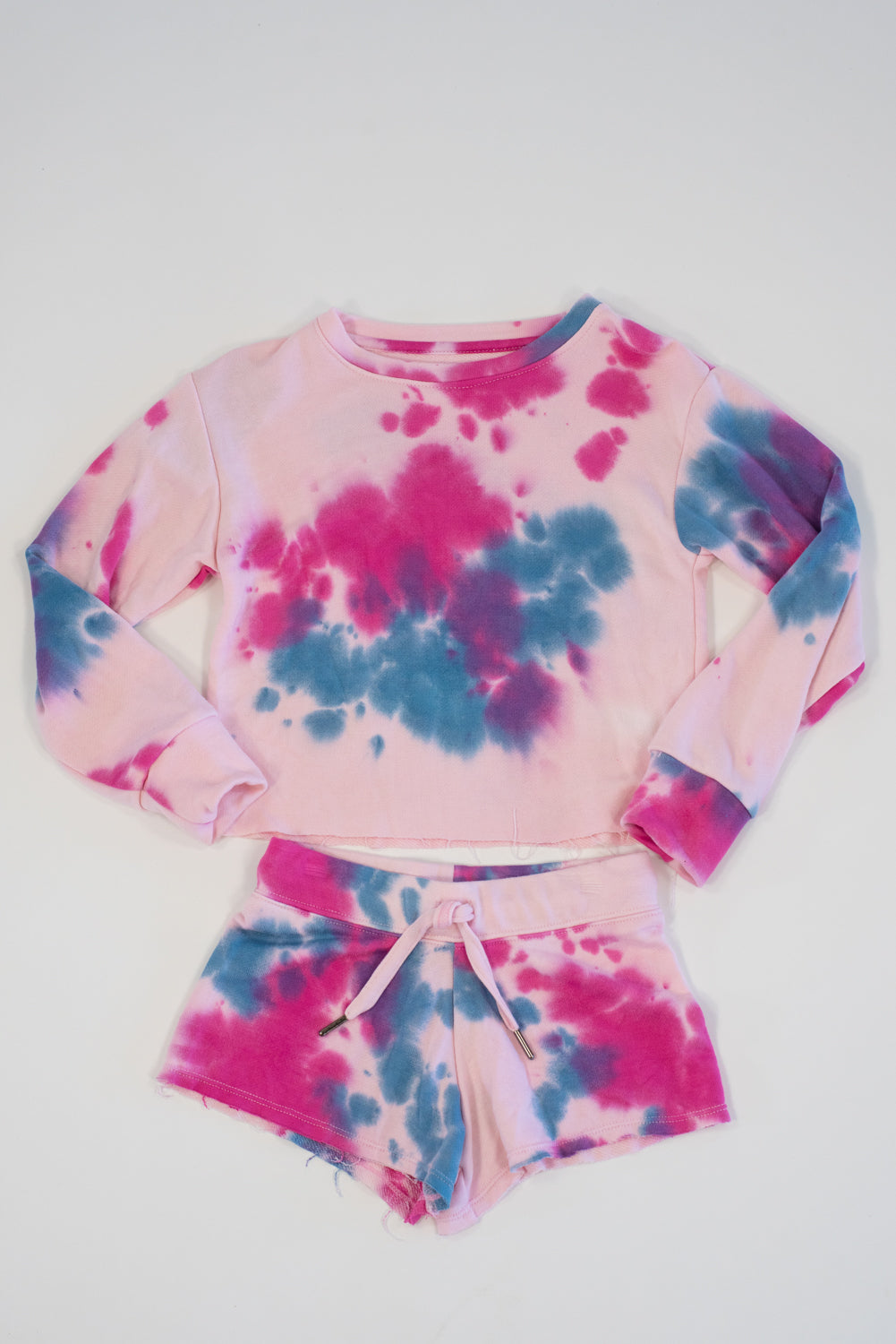 *Blush Tiedye Raw Edge Shorts*