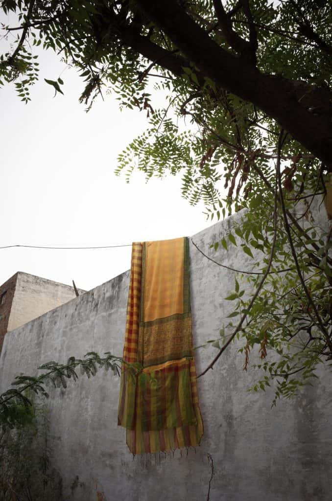 A weaver's saree hung by the terrace