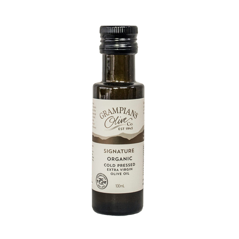 the grampians olive co signature organic cold pressed olive oil in a glass bottle with a black lid and cream label