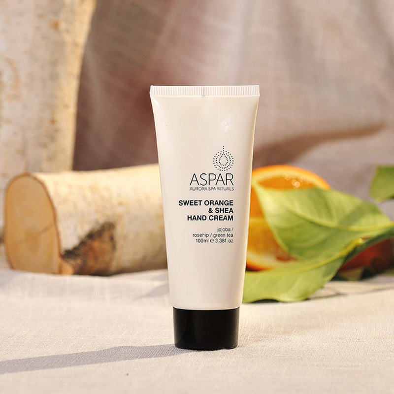 the aspar sweet orange and shea hand cream surrounded with organic natural setting