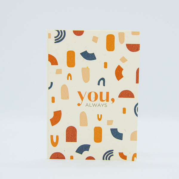a recycled paper australian made gift card with plantable seed in the paper, a burnt orange and teal geometric print on ivory recycled paper with the words you, always on the front