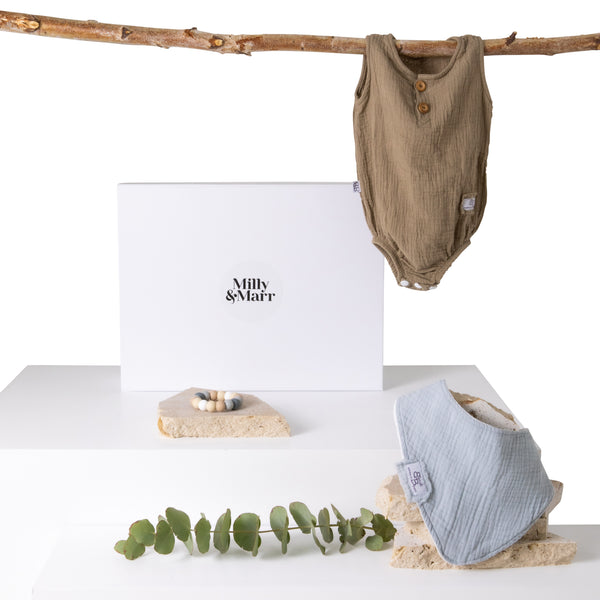 the bundle of joy newborn gift pack from milly and marr melburne including bondi booti romper in mocha and bubba organics swaddle and bottom cream