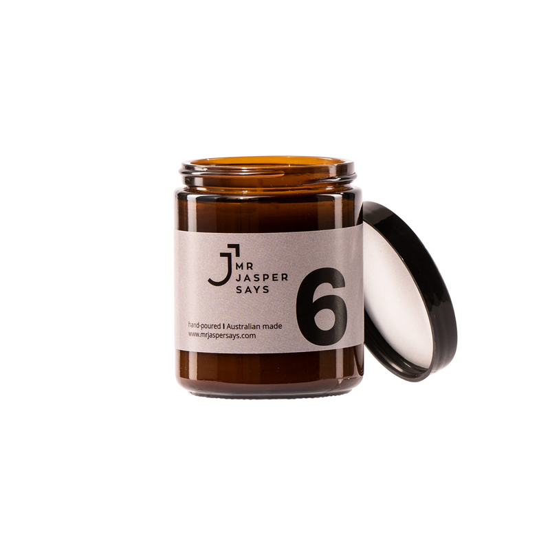 Number 6 Mr Jasper says mens candle. Made in Melbourne, Australia this candle smells sweet and has notes of  oakmoss, sea salt, amber and wood sage. With the capacity to burn up to 30 hours. Soy wax in an amber jar