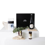 white linen tea towels with a denim blue pattern, yarra valley gourmet jam and relish and a bottle of zonzo estate wine. All packaging in a black milly and marr keepsake magnetic box