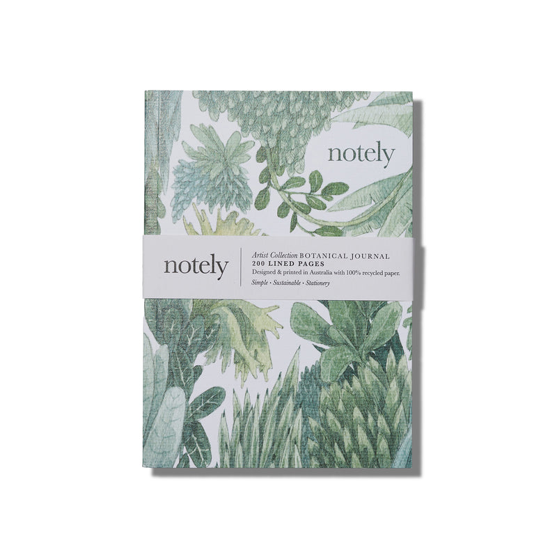 a notebook sits on a white background the cover has a watercolour look coloured illustration featuring greenery, the wrapped packaging reads artist collection botanical journal by notely