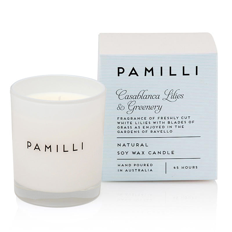 pamilli casablanca lillies and greenery candle in a glass jar with 45 hour burn time