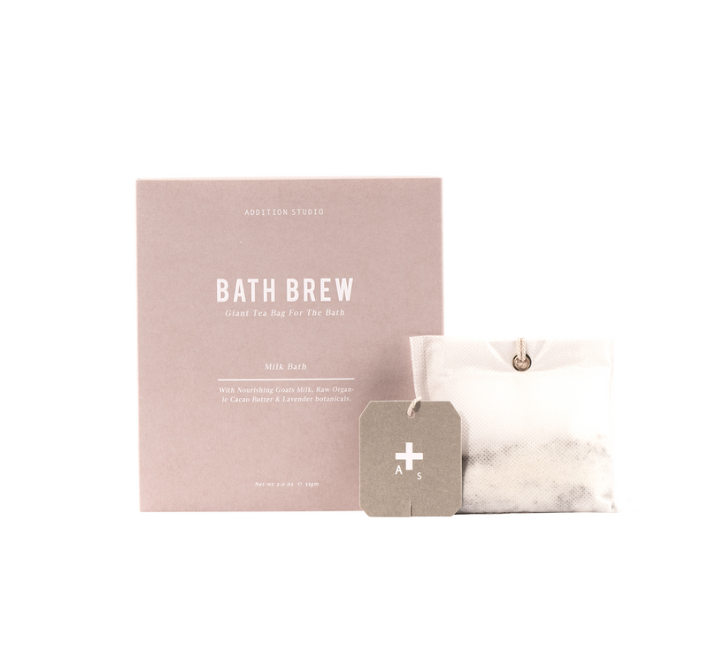 addition studio bath soak, packaged in a tea bag to drop into the bath and presented in a thick pink matt box