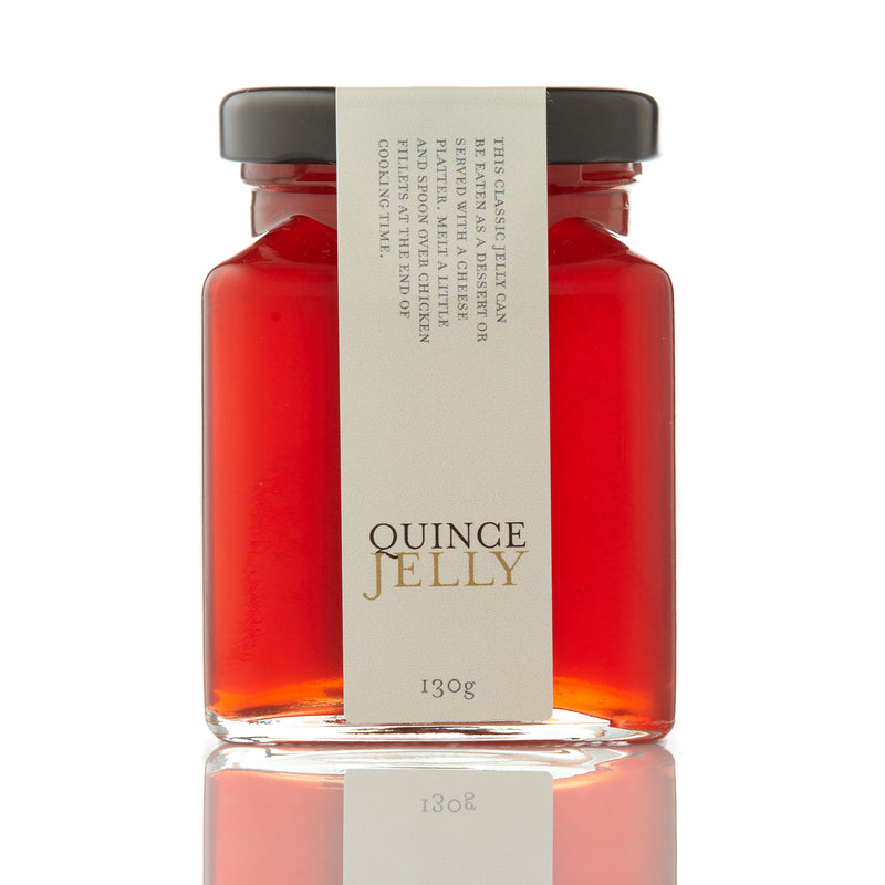 130 gram quince jelly in a glass jar with black screw top lid