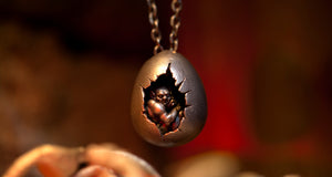 The Darkest Recess handmade silver cracked egg pendant with demon crouched inside