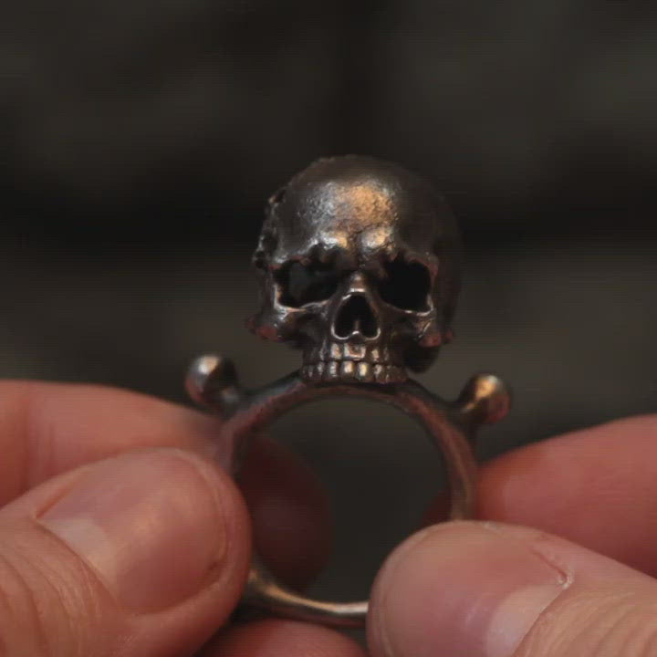 Short clip of hand sculpted eroded silver skull ring with concealed demon hidden inside. Handmade by Damian Regan
