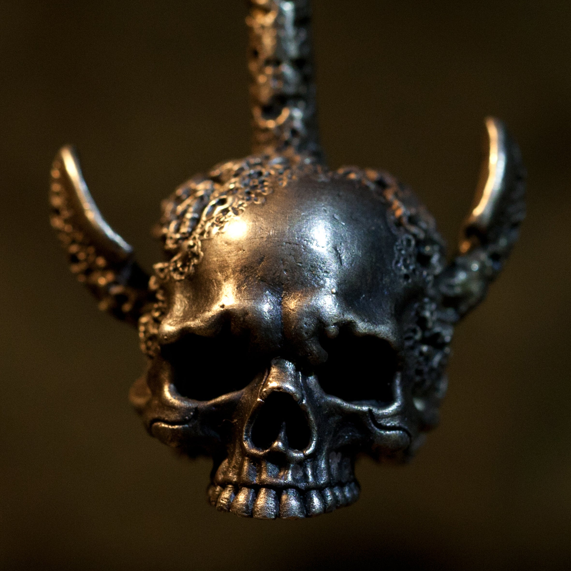 Hand sculpted silver skull and anchor pendant inspired in part by etchings of Giulio Casseri. Handmade by Damian Regan.