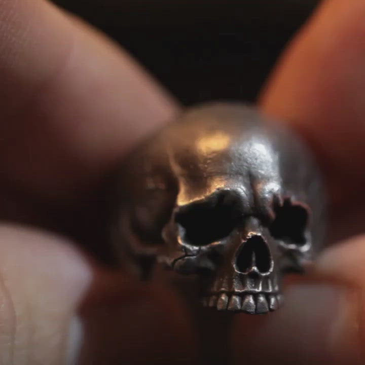 Short clip of hand carved silver skull ring hand made by Damian Regan
