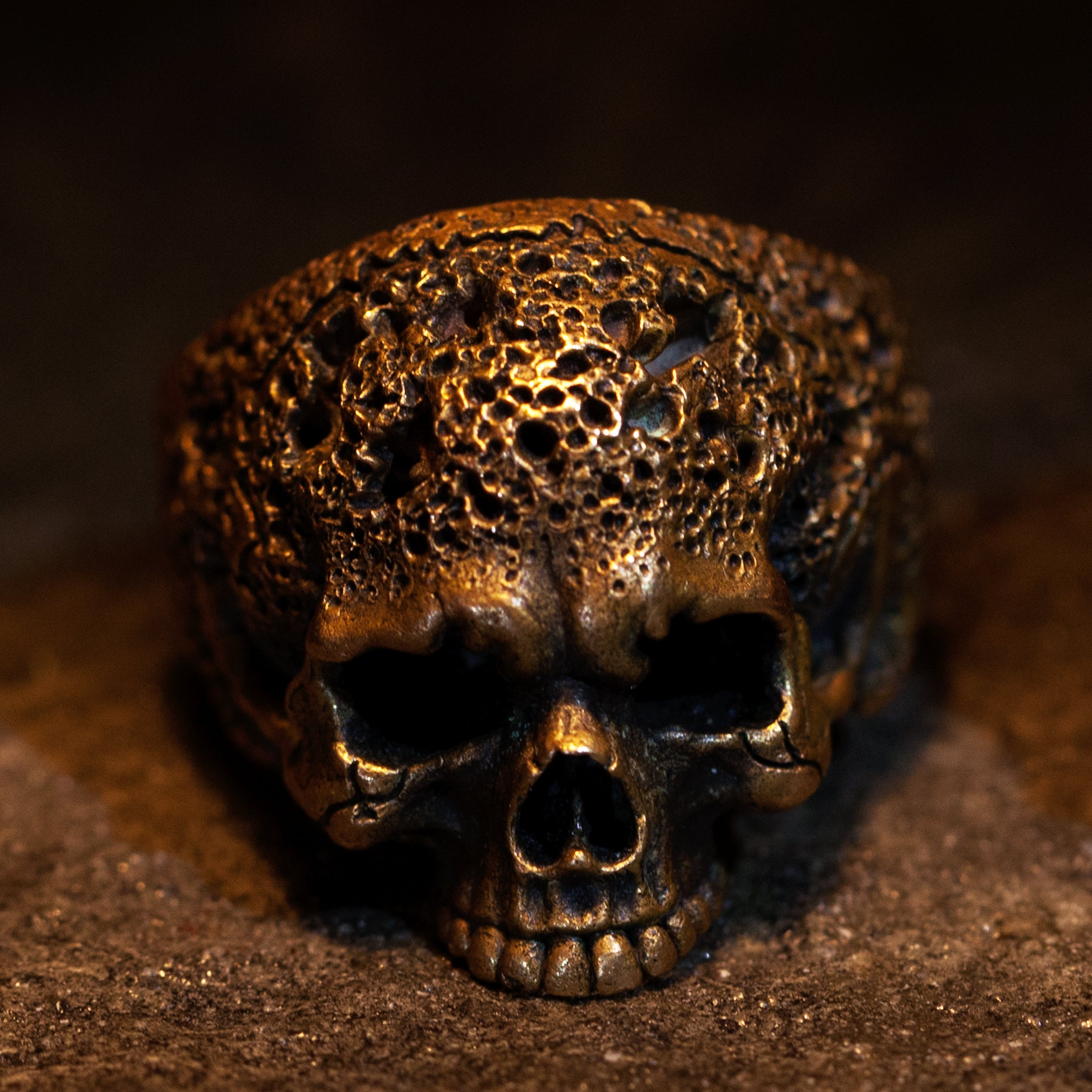 Hand sculpted eroded bronze skull ring. Hand Sculpted by Damian Regan.