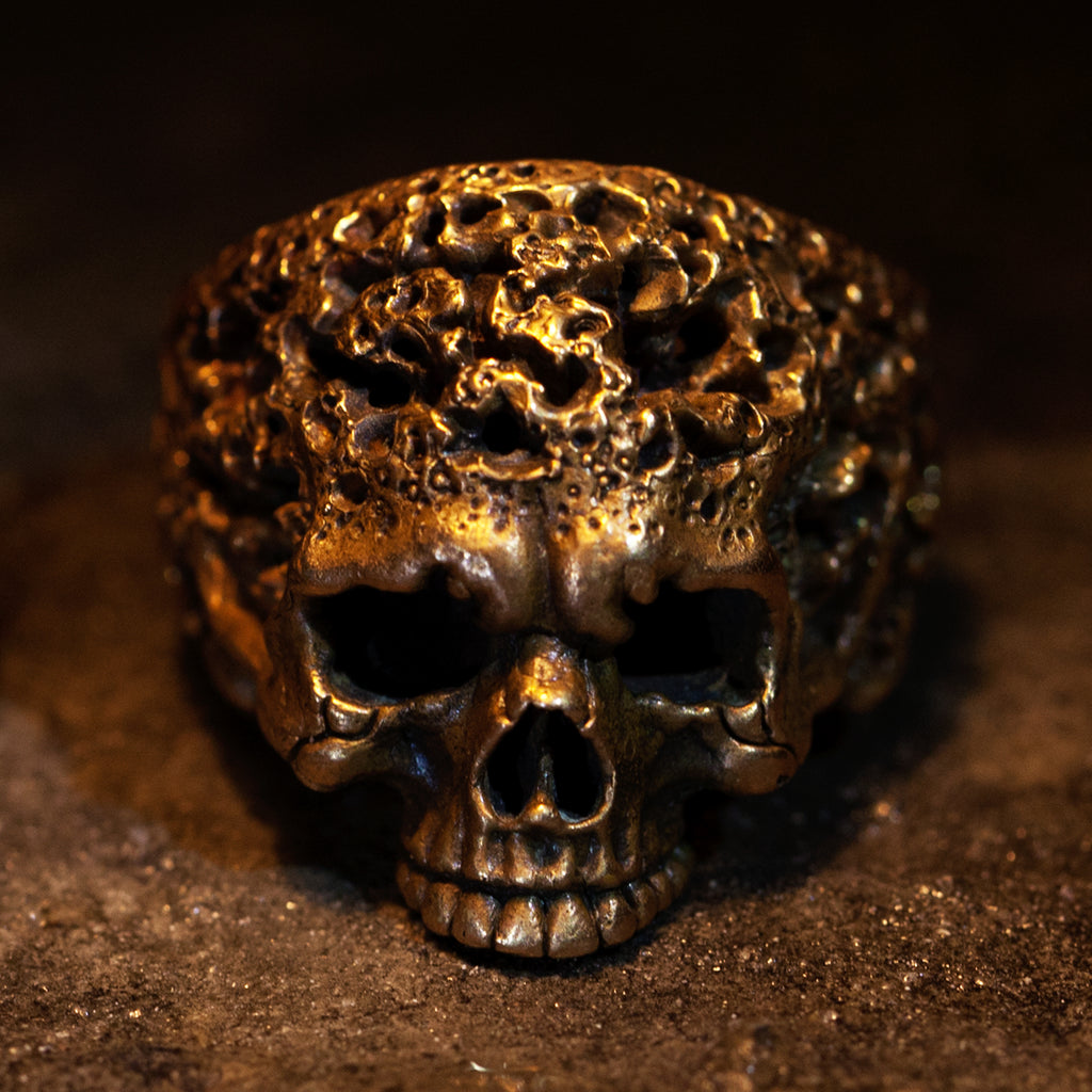 Hand sculpted heavily eroded bronze skull ring. Hand Sculpted by Damian Regan.