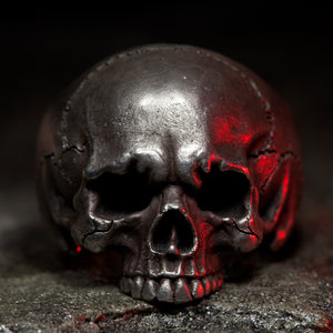 Hand sculpted silver skull ring with extreme detail. Handmade by Damian Regan