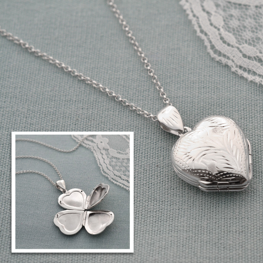 Silver Four Piece Heart Locket by Martha Jackson