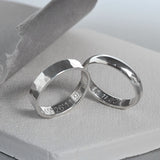 Silver Affirmation rings in different styles including Hammered and Polished finish on white tile with grey background