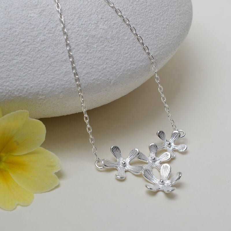 Silver four blossoming flowers pendant necklace