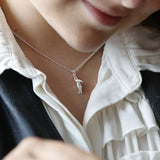 Silver necklace with a silver flying hare pendant