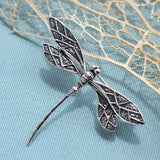 Silver dragonfly in flight brooch