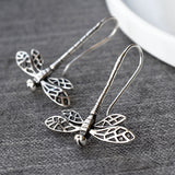 Silver dragonfly in flight pull through earrings