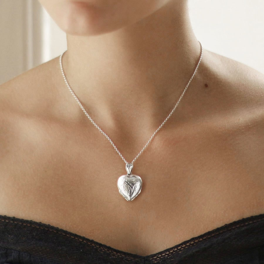 Silver unfolding heart locket with four spaces