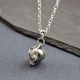 Meteorite Spinning Orb Necklace
