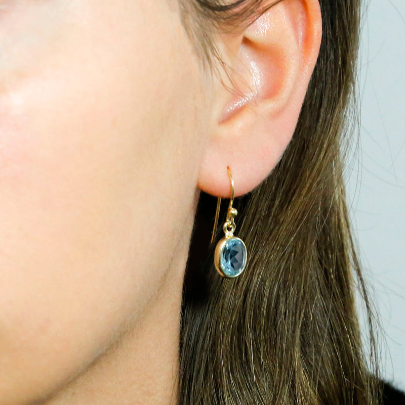 Gold Plated Blue Topaz Oval Earrings