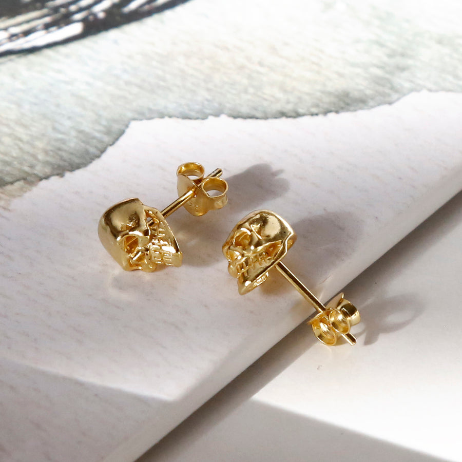 sterling silver mini gold skull studs showing facial detail