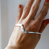 Sterling silver hidden heart bangle open on model