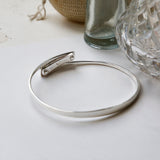 Sterling silver hidden heart bangle showing inside and back