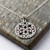 Silver Round Floral Necklace by Martha Jackson
