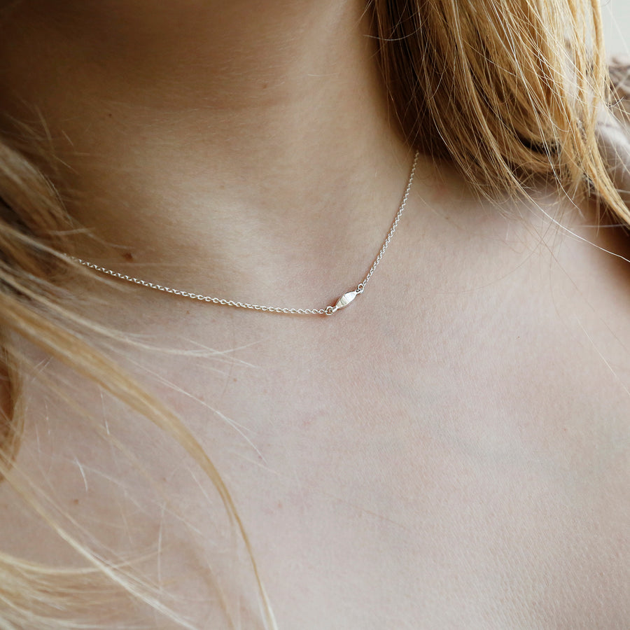 Sterling silver delicate rhombus necklace on model