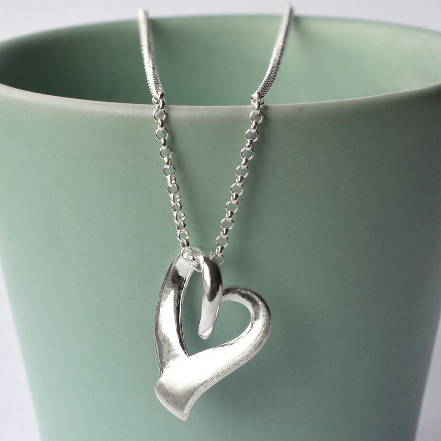 Silver Ribbon Heart Necklace by Martha Jackson