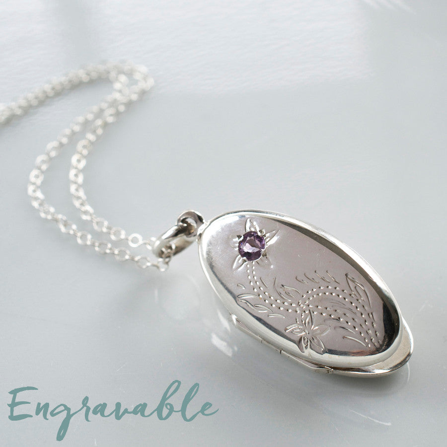 Silver floral oval locket with embedded amethyst gemstone