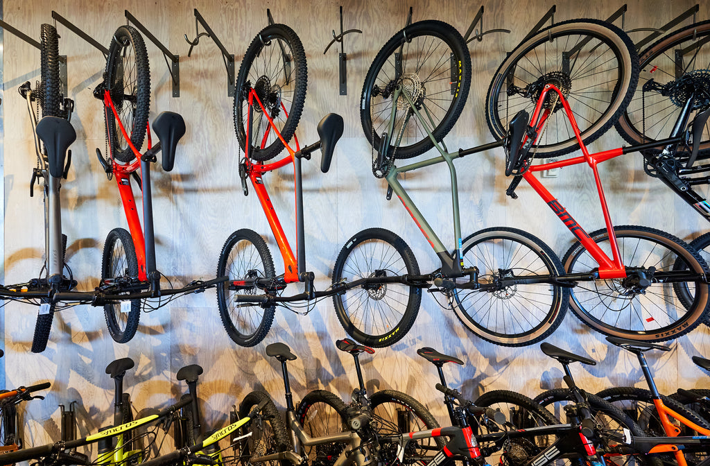 Bikes hanging on the sales wall at Contender
