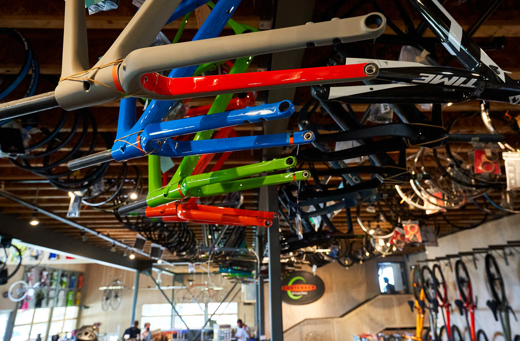 Bike Frames Hanging on the ceiling at Contender