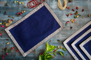 A Tiny Mistake Set of 4 Silver Border on Dark Blue Stiff Jute Picnic Mats