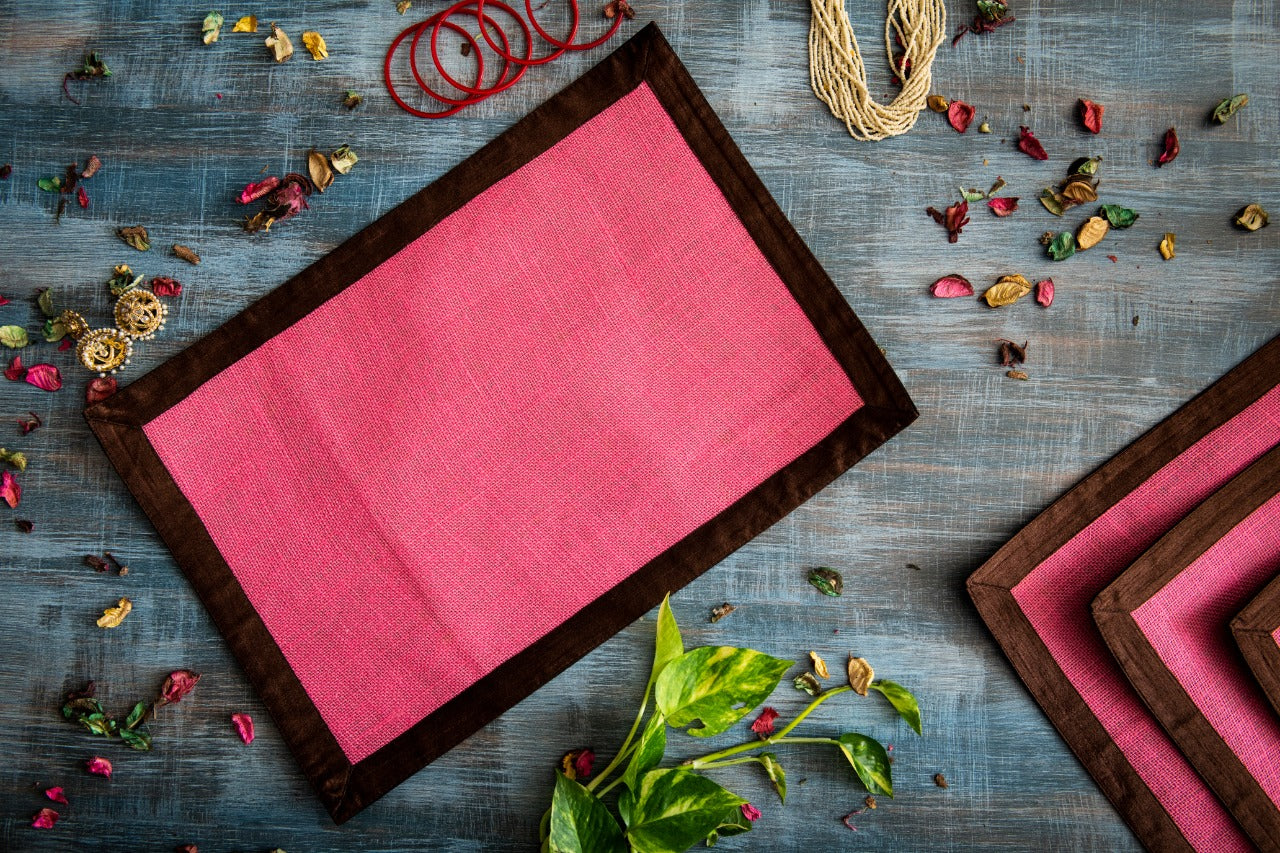 A Tiny Mistake Set of 4 Brown Border on Pink Stiff Jute Picnic Mats