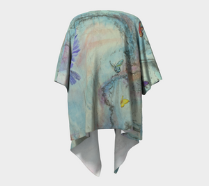 Dovetailing kimono is made of a silk knit fabric with turquoise, yellows, blues and purple doves