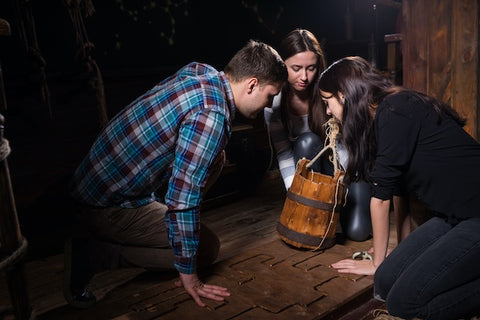 Group of friends working together to solve a puzzle