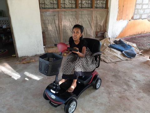 Chamila with her new Mobility Scooter