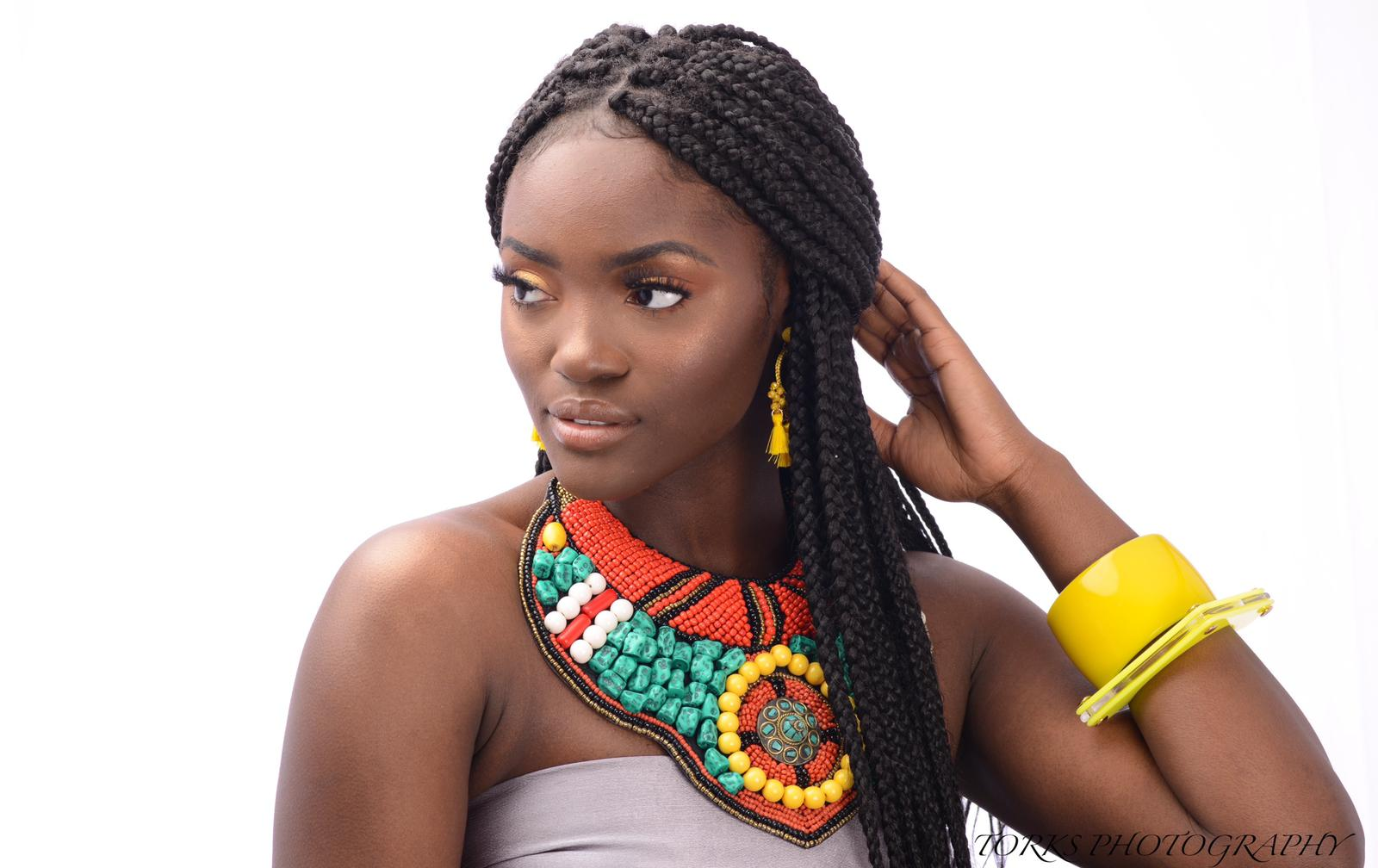 african girl with turquoise collar necklace and earrings