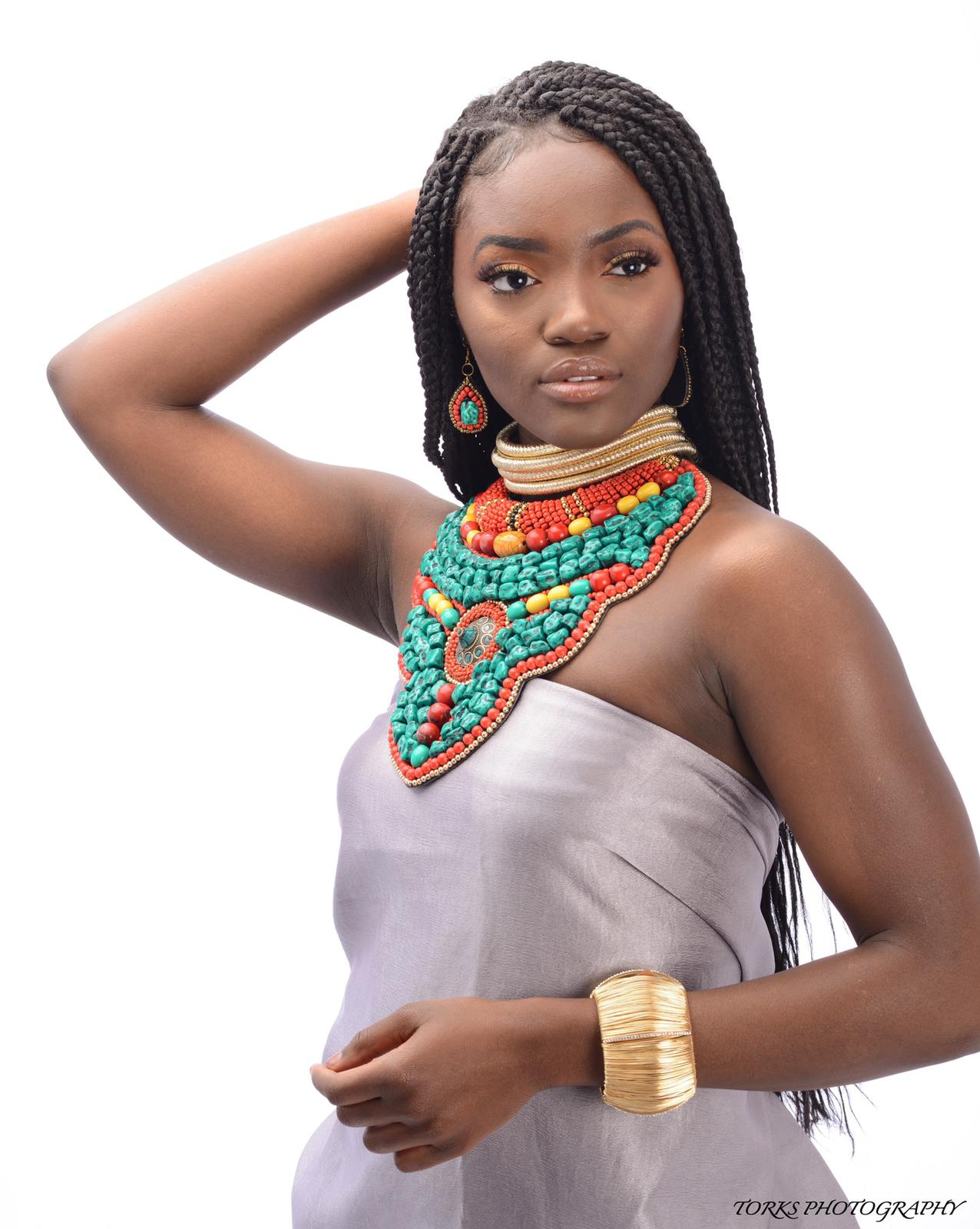 african model with turquoise collar necklace
