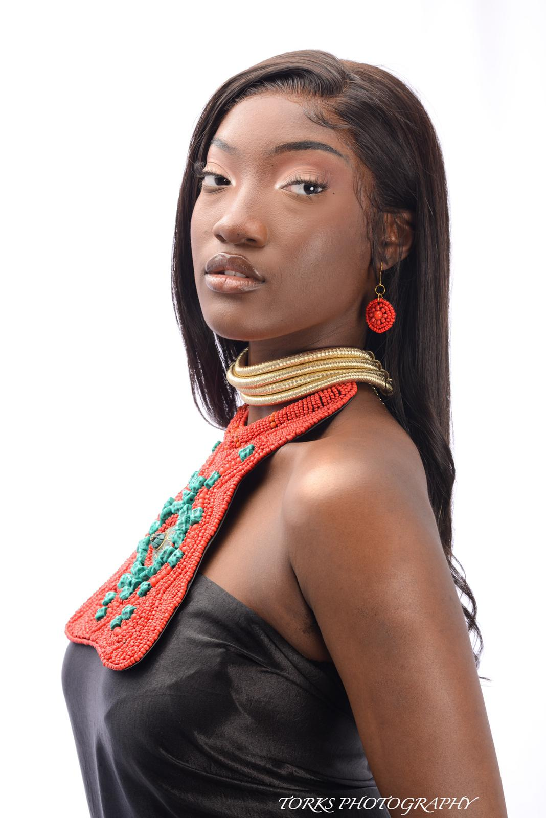 african woman with red and turquoise bead collar