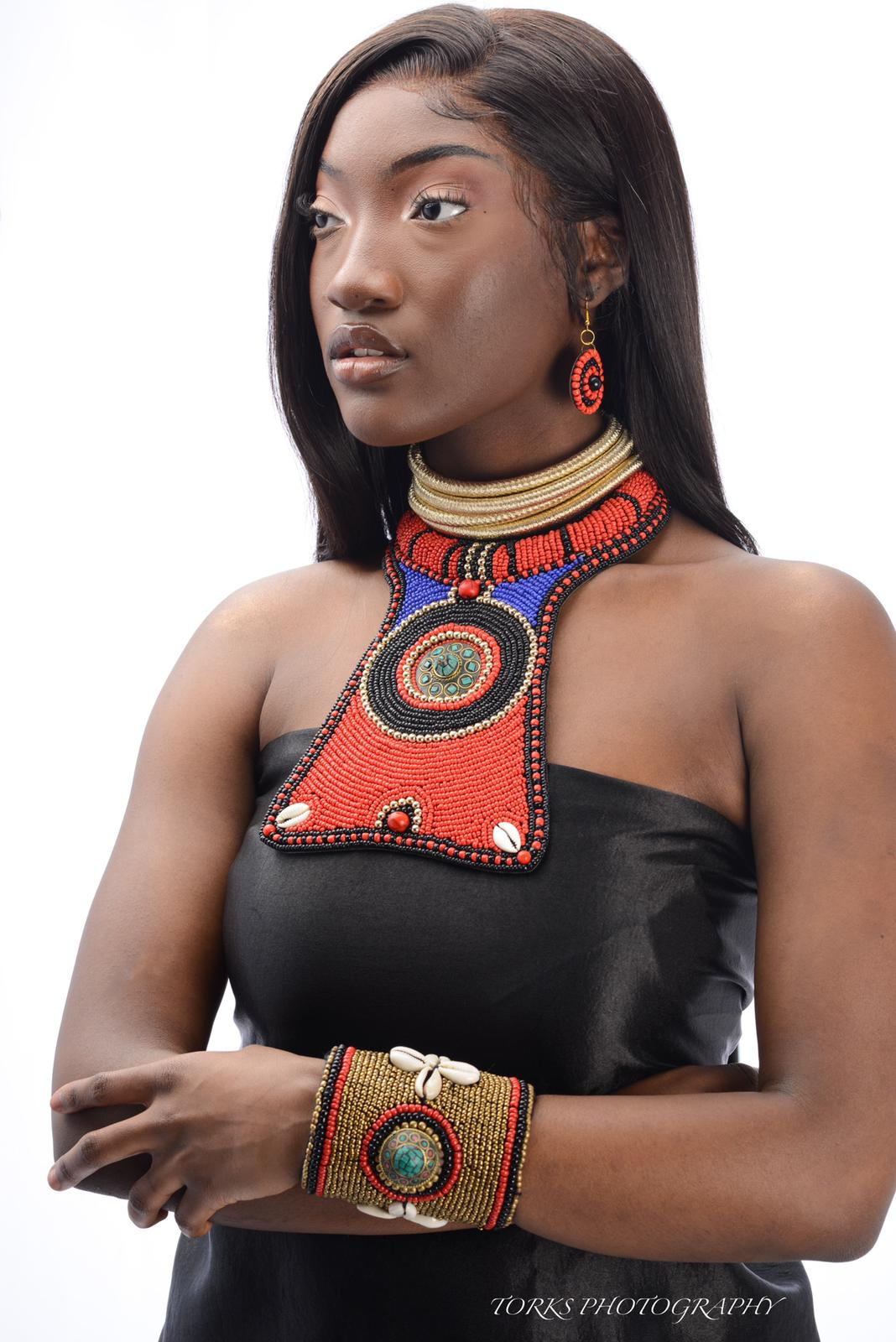 african model with colorful raised bead collar and cowrie shells