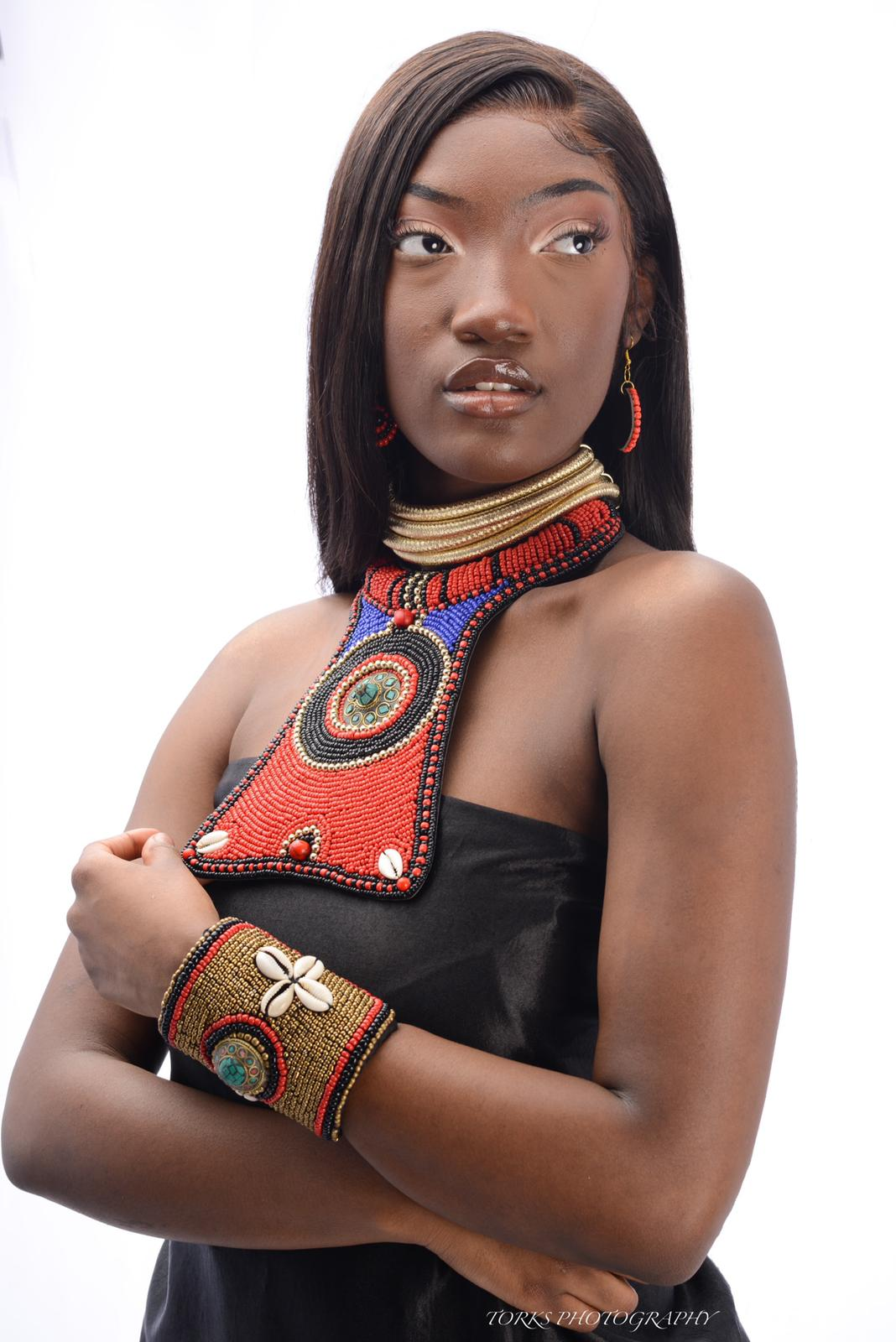 african model with colorful rasied bib necklace and matching bracelet