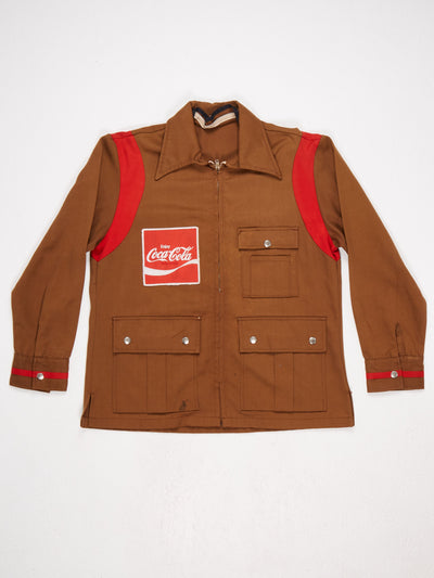 Coca  Cola Zip Up Jacket  Small Badge on front and larger badge on the reverse  Button Cuffs Brown / Red / White Size Large